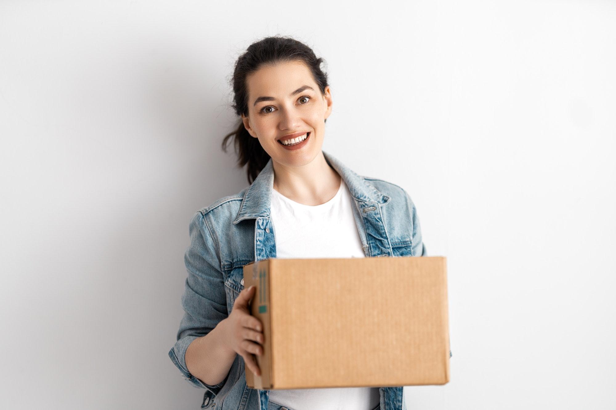 Happy woman with cardboard box.